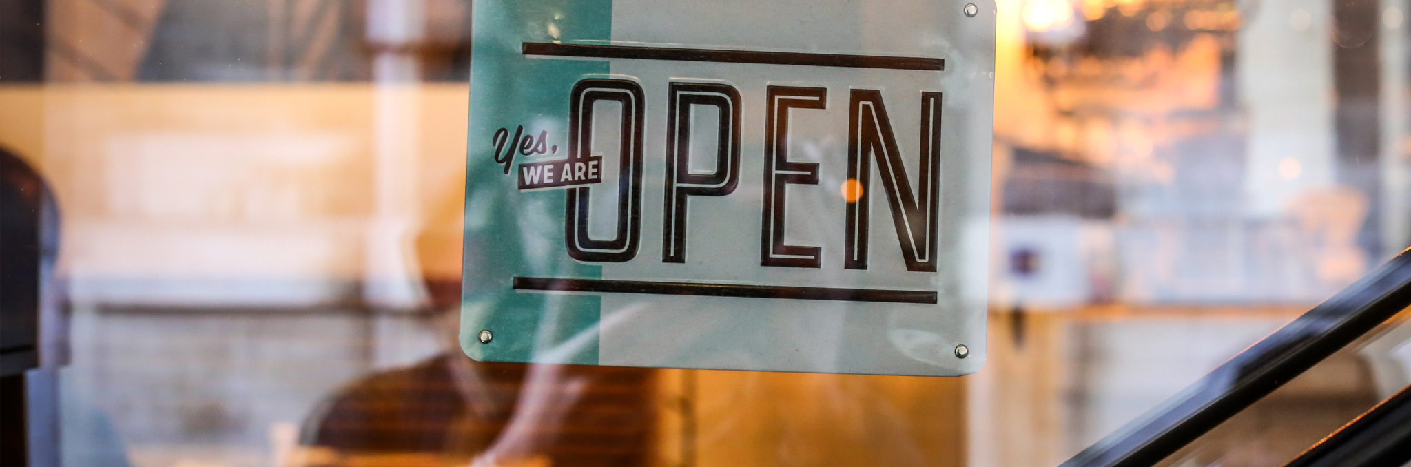 Yes we are Open sign. Photo by Alexandre Godreau on Unsplash