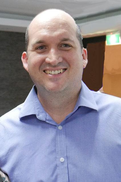 Portrait photograph of man smiling