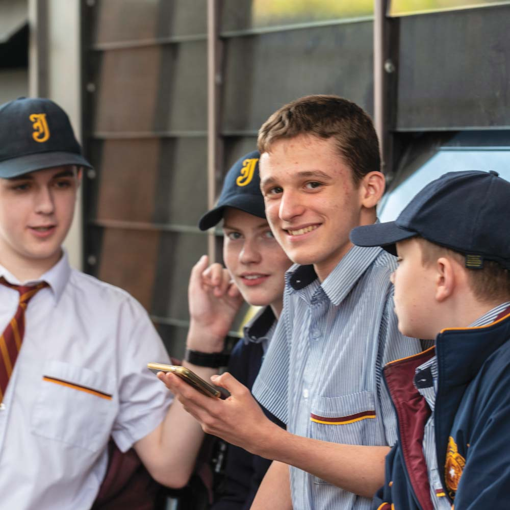 Group of boys in school uniform talking