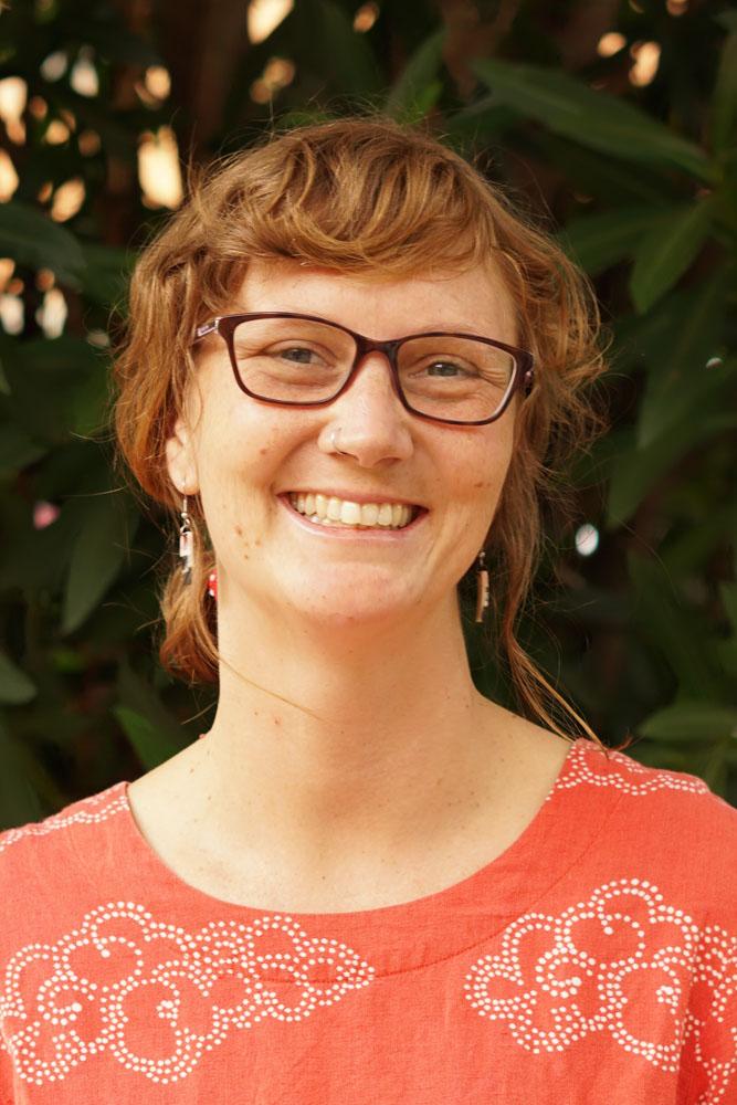 Portrait photograph of woman smiling